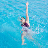 Woman in goggles swimming back crawl style Stock Images