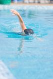 Woman in goggles swimming front crawl style Royalty Free Stock Image