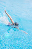 Woman in goggles swimming front crawl style Stock Image