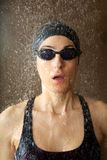 Woman with goggles under water drops Stock Photography