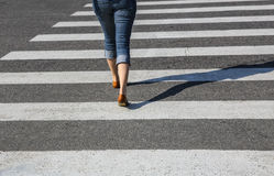 Woman going on the crosswalk Royalty Free Stock Photography