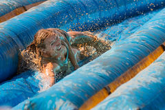 Woman going doing the slide. Royalty Free Stock Images