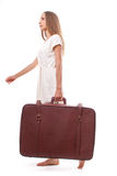 Woman going with heavy suitcase, isolated on white royalty free stock images