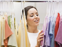 Woman Going Through Her Outfits Stock Photos