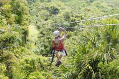 Woman going on a jungle zipline adventure Royalty Free Stock Photo