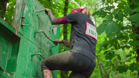 Woman going through obstacle course stock video
