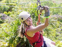 Woman Going On A Jungle Zipline Adventure Royalty Free Stock Image