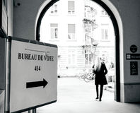 Woman going ot pooling station French Elections 2nd round. STRASBOURG, FRANCE - MAY 7, 2017: Bureau de vote sign in French city next to pooling place during the Stock Photography