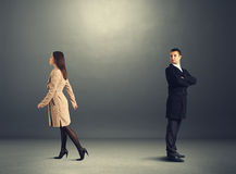 Woman going out and man looking at her. Young women going out and men looking at her Stock Photography
