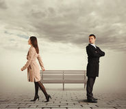 Woman going out of the man. Offended young women going out of the man Royalty Free Stock Photos