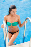 Woman going out from swimming pool Royalty Free Stock Photography