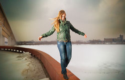 Woman going on parapet stock photo