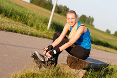 Woman going rollerblading Stock Photography
