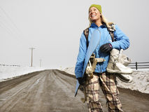 Woman going snowboarding. Royalty Free Stock Photo