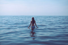 Woman is going for a swim. Royalty Free Stock Photo
