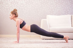 Woman is going to do press-ups Stock Photos