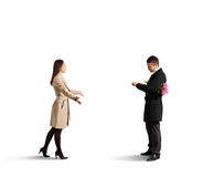 Woman going to man looking at the watch Royalty Free Stock Photos