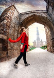 Woman going to Qutub Minar Royalty Free Stock Photography