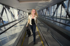Woman going on a travelator Stock Photo