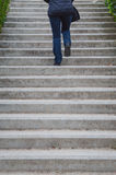 Woman going upstairs Royalty Free Stock Image