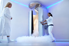 Woman going for whole body cryotherapy royalty free stock photos