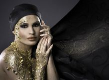 Woman in gold Stock Photo