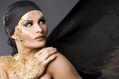 Woman in gold Royalty Free Stock Photo