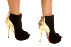 Woman gold black shoes Royalty Free Stock Images