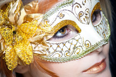 Woman in gold carnival mask Stock Photography