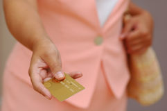 Woman With a Gold Credit Card Stock Images