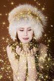 Woman with gold dust. Redhead woman in winter clothes with gold dust Royalty Free Stock Photo