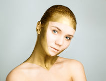Woman with gold face make up Stock Photo