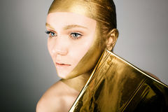 Woman with gold face make up Royalty Free Stock Photo
