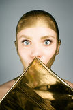 Woman with gold face make up Royalty Free Stock Photography