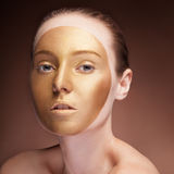 Woman with gold face make up fashion on brown Stock Photos