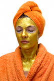 Woman with gold face mask stock image