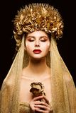 Woman in Gold Flower Crown, Fashion Model Beauty Makeup, Bride in Golden Veil holding Rose stock photos