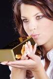 Woman and gold ingots Stock Image