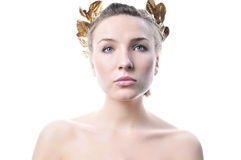 Woman with a gold laurel wreath. Stock Images