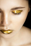 Woman with gold make-up Royalty Free Stock Photo