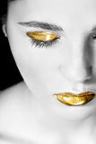 Woman with gold make-up Royalty Free Stock Image