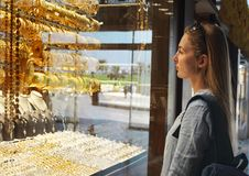 Woman on gold market in Sharjah City. United Arab Emirates stock photo