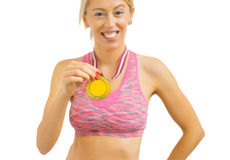 Woman with gold medal around her neck Stock Images