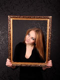 Woman With Gold Picture Frame Royalty Free Stock Photo