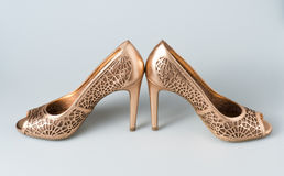 Woman gold shoes on background. Woman gold shoes on gray background Stock Photography