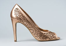 Woman gold shoes on background. Woman gold shoes on gray background Royalty Free Stock Photo