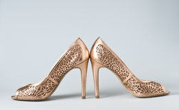 Woman gold shoes on background. Woman gold shoes on gray background Stock Photo