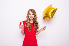 woman with gold star shaped balloon smiling and drinking champagne Royalty Free Stock Photo
