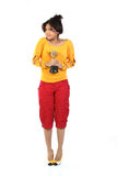 Woman  with the gold trophy. Young woman feeling happy with the gold trophy Royalty Free Stock Photography