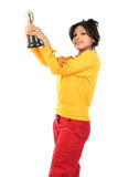 Woman  with the gold trophy. Young woman feeling happy with the gold trophy Royalty Free Stock Image